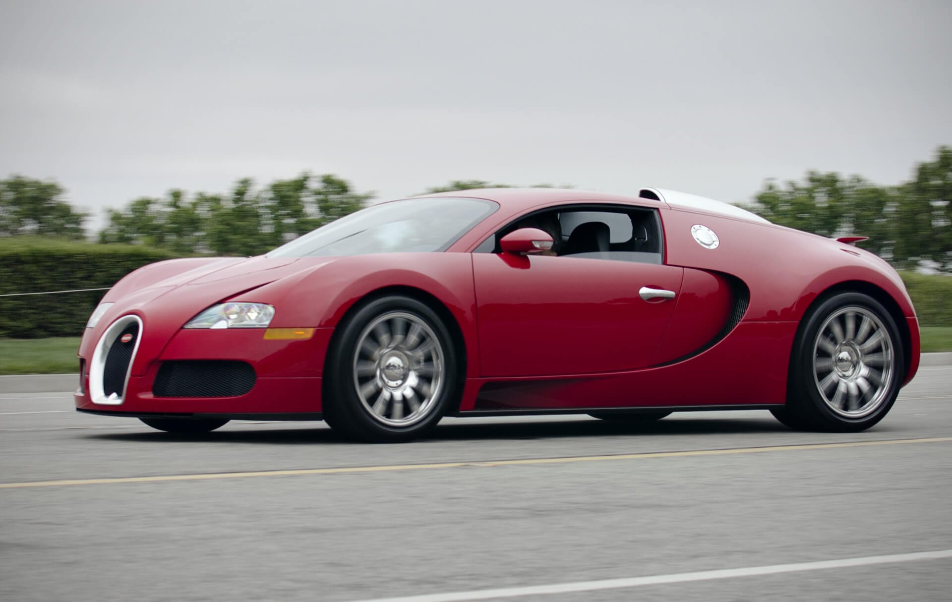 Red Bugatti Veyron on the road